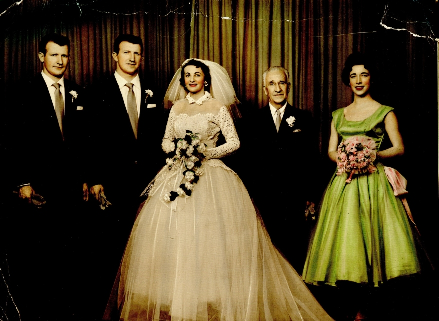 Noline, Leo and the wedding party. ca. 1956