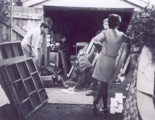 27-30th August 1969: Members of Wollongong Actor's Studio storing props from production in Frederick and Violet Bond's Garage. Prudence Bond leaning in foreground.