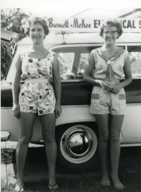 Maria and Judy Barnett: 1960 Teenage girls, Maria (m. Adams) and Judy (m. Bourke) (nee Barnett) wearing hotpants standing in front of their 1958 Standard Vanguard Six Estate car