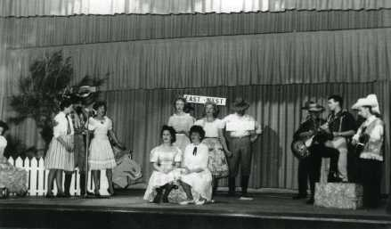'The Western' scene in Council Concert Wollongong Town Hall. 1962 Singers and guitar players dressed in cowboy gear on stage July 8 1962.
