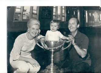 Ray Reeve and Margaret (Maloney) Reeve in their dance school studio with toddler Adam Reeve in giant Ballroom Dancing cup