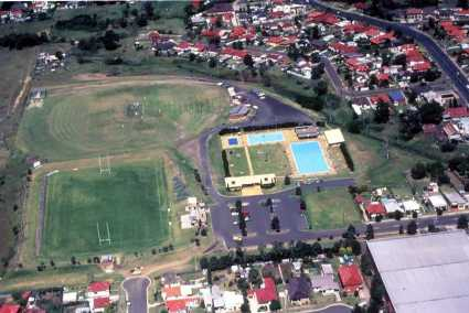 Robert Ziems Oval Corrimal – aerial view of pool Date? (taken pre community centre which opened in 1997)