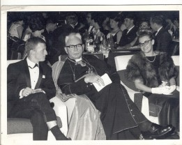 CYO Ball – Sue sitting with Reverend Thomas McCabe, Bishop of Wollongong and John Roach, Date: 12 August 1966