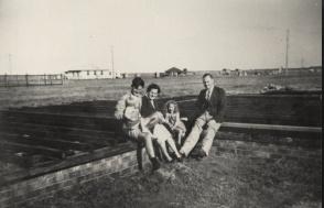 Les Barnett, Joan Barnett, Judith Barnett, Maria Barnett, and man - house footings, 15 Kareela Road, Woonona