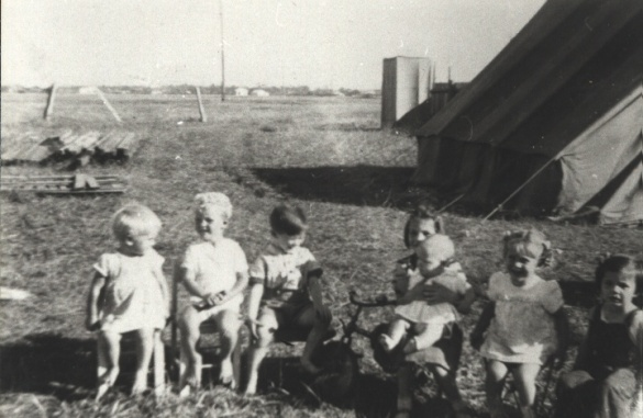 Maria B, unknown boy, Brian M, Marie U (holding baby Christine M), Judith B, Anita U - Maria Barnett's 2nd Birthday, May 1947 - 15 Kareela Road, Woonona