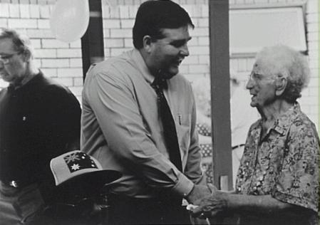 David Campbell congratulating Rube Hargrave on her OAM at a party held at Towradgi Retirement Village on 26 January, 1993 - P16382