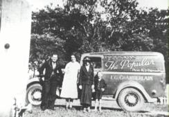 """Edward George Chamberlain's van used for """"The Popular"""" cafe and provision shop which was located on the corner of Lawrence Hargrave Drive and McCauley Street, Thirroul. Rube Chamberlain and friends standing in front of the van - P16395"""